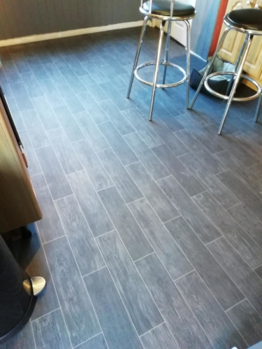Non-slip felt backed tile effect vinyl flooring.