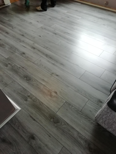 Grey laminate flooring.