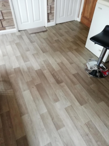 Non-slip commercial vinyl in a natural oak effect.